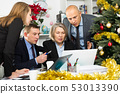 Serious business people working at office 53013390