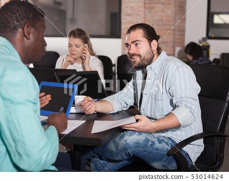 Multiracial partners talking 53014624
