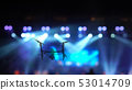 Closeup silhouette of Drone flying for taking video of Concert crowd and Abstract blurred photo of spotlight in conference hall, musical and concert concept 53014709