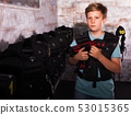 Boy ready for lasertag game 53015365