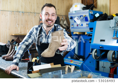 Worker showing fixed shoes 53016493