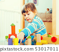 serious 3 years child playing with toys 53017011
