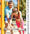Girl with father doing push-ups on gymnastics bar 53018462