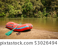 Whitewater rafting boat on shore of mountain river ready for adventure 53026494