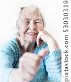 Happy 96 years old elderly woman giving a thumb up and looking at camera. 53030319