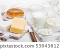 Fresh dairy products in vintage wooden box on 53043612