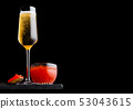 Elegant glass of yellow champagne with red caviar 53043615