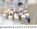 Delicious colorful wedding cupcakes with flower 53103936