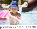 Happy little boy at the pool on summer holidays 53129708