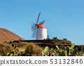 Windmill on blue sky background in cactus garden, 53132846