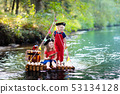 Kids playing pirate adventure on wooden raft 53134128