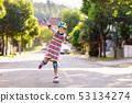 Child on inline skates. Kids skate roller blades. 53134274