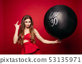 Cool and beautiful model with big balloon posing 53135971