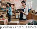 Pregnant business owner woman working at office 53136576