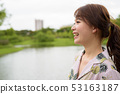 Young beautiful Asian tourist woman relaxing at the park 53163187