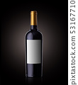 A bottle of red wine on a black background, with a clear label. 53167710