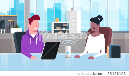 mix race people sitting at workplace desk man woman using intelligent smart speaker with voice 53168106