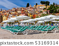 Menton. Antique multi-colored facades of medieval houses on the shore of the bay. 53169314