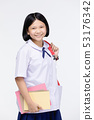 Cute girl in student's uniform with stationery on 53176342