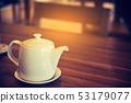 white teapot on wood table. 53179077