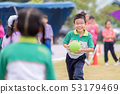 boy runs in the lawn during the competition, 53179469