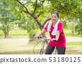 Beautiful aged asian woman riding bicycle  53180125