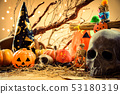 Halloween pumpkin and variety of ornaments on wood 53180319