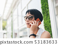 Asian woman sit and talk on cellphone 53183633