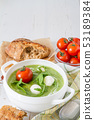 Arugula and tomatoes puree soup in white bowl 53189384