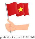 Hand holding and waving the national flag of Vietnam. Fans, independence day, patriotic concept 53193760