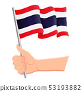 Hand holding and waving the national flag of Thailand. Fans, independence day, patriotic concept 53193882