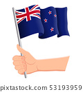 Hand holding and waving the national flag of New Zealand. Fans, independence day, patriotic concept 53193959