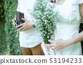 The man holding classic camera beside woman 53194233