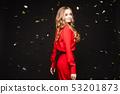 Elegant woman in long black dress posing in studio 53201873