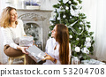 Portrait of a mother with teen daughter at home 53204708