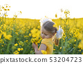 Little girl romantic in field with yellow flowers 53204723