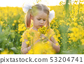 Little girl romantic in field with yellow flowers 53204741