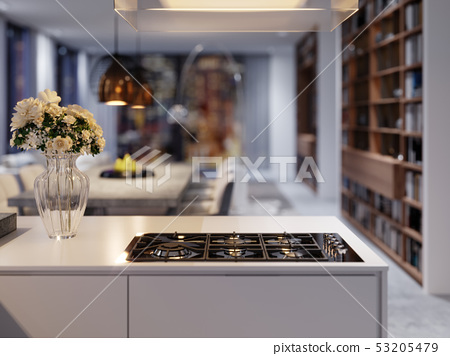 Vase of flowers on the kitchen countertop in the 53205479