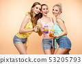 Friends in casual clothes drinking lemonade during 53205793