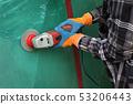 Old metal door repairing, rust and paint cleaning 53206443
