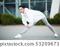 Fitness girl. Young sports woman stretching in the modern city. Healthy lifestyle in the big city 53209673