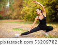 Fitness. Woman doing stretching exercise on park 53209782