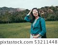 girl hiking at hills near world famous landmark 53211448