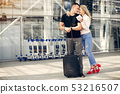 Beautiful couple standing in a airport 53216507
