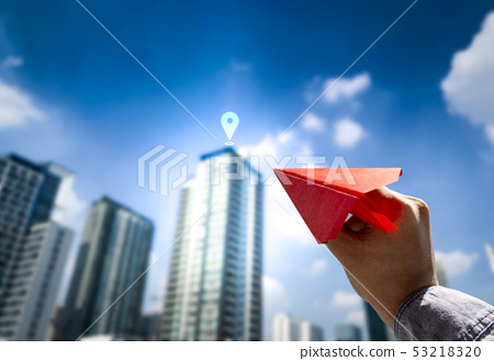 Business man in suit holding red paper airplane 53218320