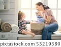 family doing laundry 53219380