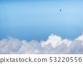 The lonely paraglider pilot above clouds. 53220556