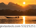 silhouette image of a  boat sailing in a dam. 53225251