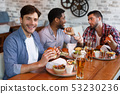 Mates Spending Time In Pub, Eating Burgers And Drinking Beer 53230236