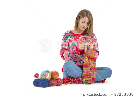 Young woman knitting isolated on white background 53233939